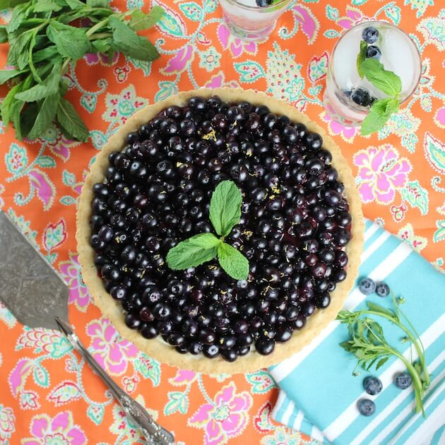 Summer Blueberry Pie with shortbread crust on festive tablecloth