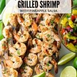 shrimp skewers with pineapple salsa on platter