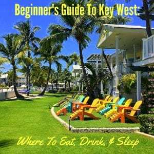 Bright green lawn with colorful Adirondack chairs on Key West, FL