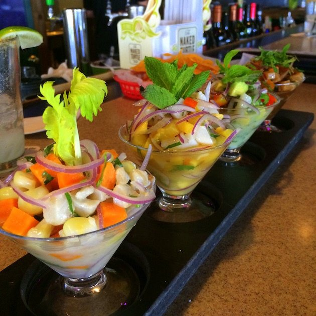 Four glass dishes of different Ceviche preparations at Turtle Kraals Restaurant Key West