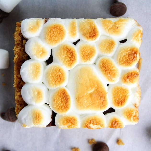Toasted marshmallows on top of one Baked Nutella S\'mores square