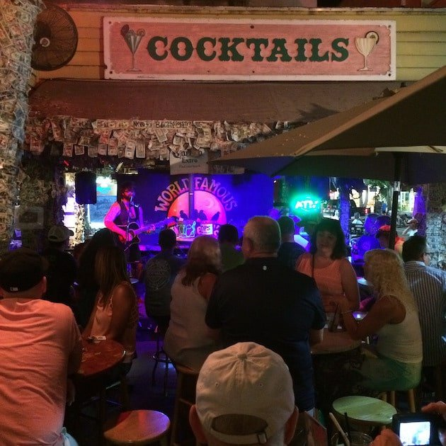 Musician playing live in front of crowd at a bar