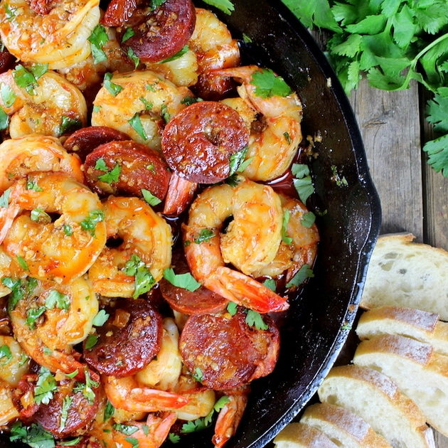 Partial skillet of Sun-Dried Tomato and Shrimp appetizer with chorizo