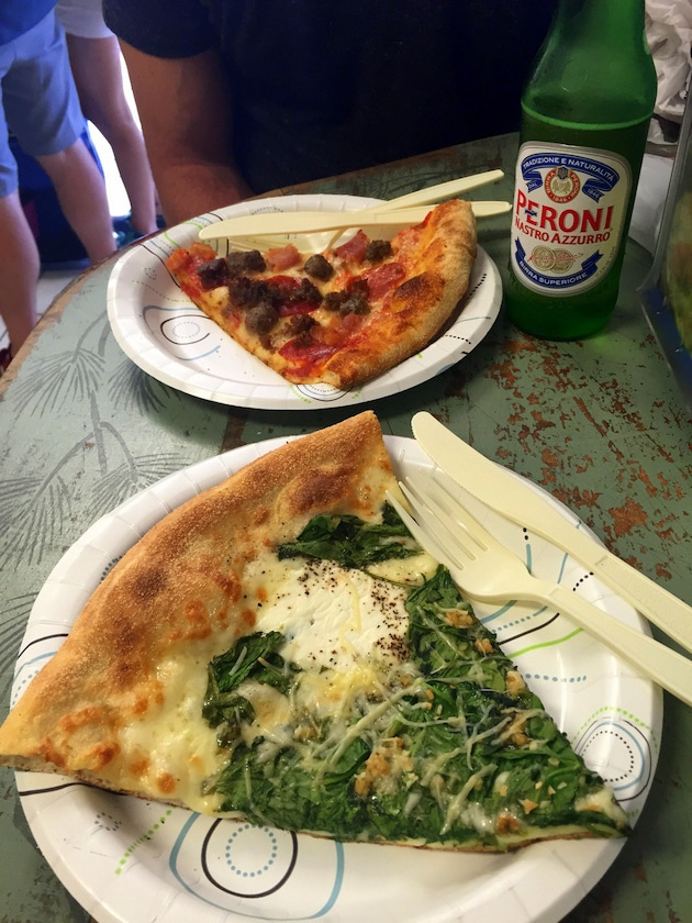Slices of pizza on paper plates with bottle of Italian beer from Duetto Pizza & Gelato in Key West