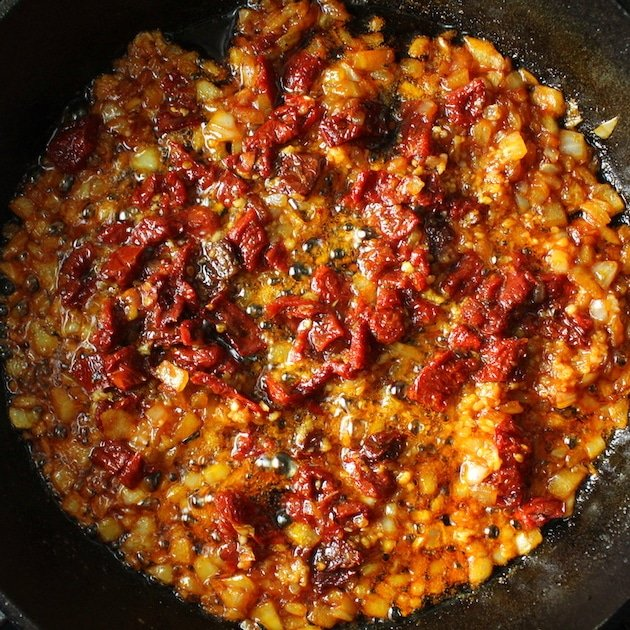 Sun-Dried Tomato cooking in skillet with garlic and onion