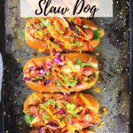 5 asian slaw dogs on a cookie sheet