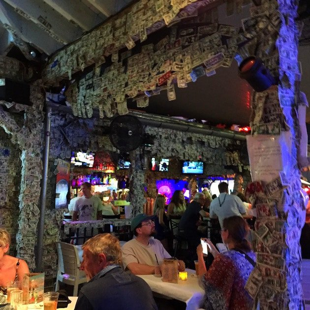 Key West Willie T\'s Bar with hundreds of dollar bills hanging everywhere