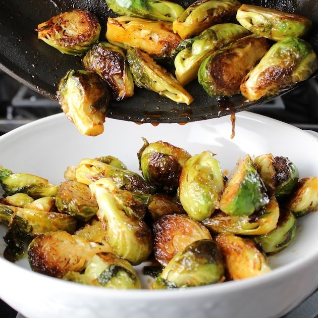 Transferring caramelized Brussels Sprouts to white serving dish