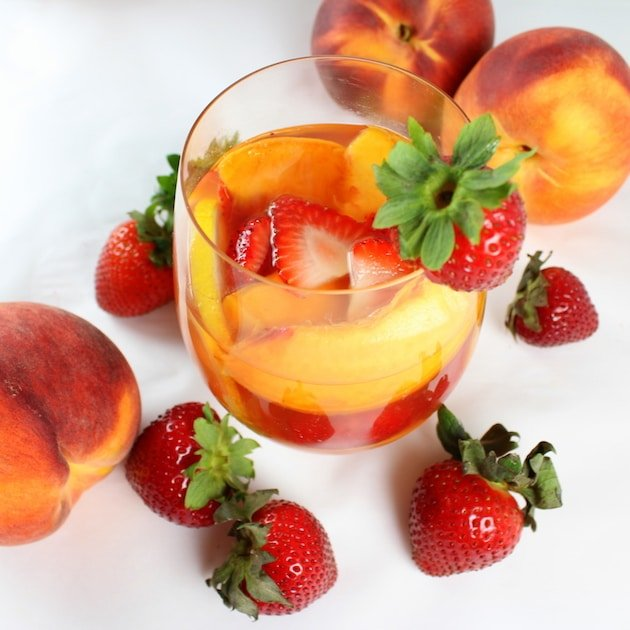Strawberry Peach Rosé Sangria in a glass with strawberry garnish