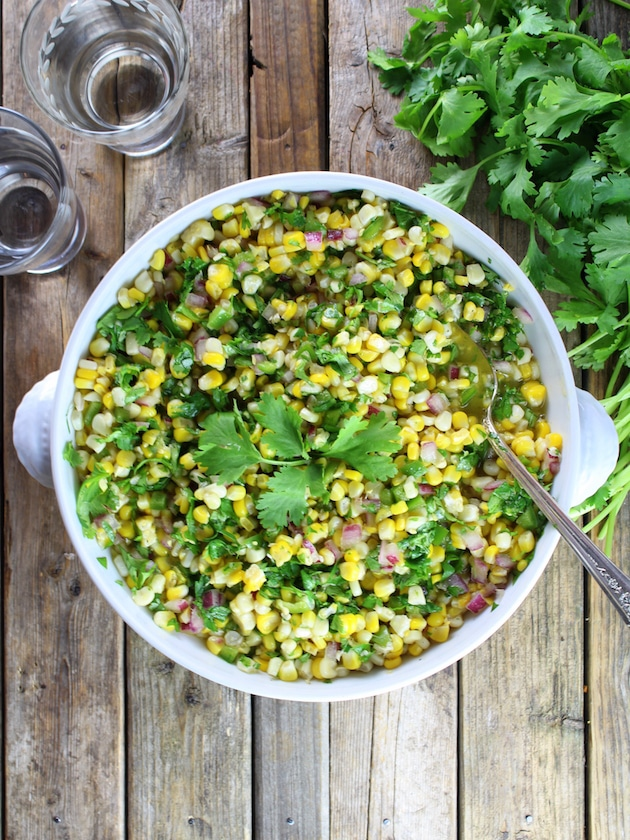 Jalapeño Cilantro Corn Salad -  with fresh corn off the cob, red onion, jalapeños & cilantro.  Fresh, sweet and flavorful… It's sunshine in a bowl!  #corn  https://tasteandsee.com