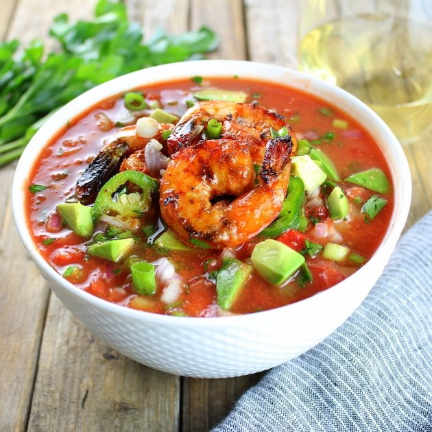 Eye level bowl of Classic Gazpacho with Spicy Grilled Shrimp