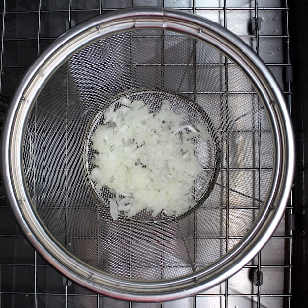 Draining grated onion in a strainer