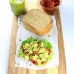Open faced Chicken salad sandwich on a cutting board