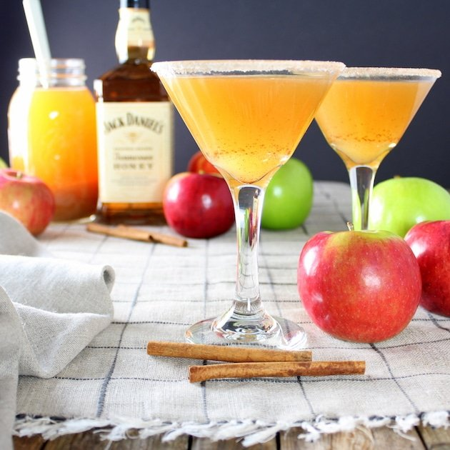 Martini glasses on table with apple cider martinis