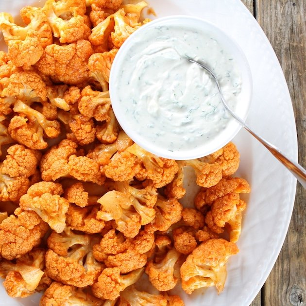 Partial platter over top Roasted Buffalo Cauliflower with Cheesy dipping Sauce