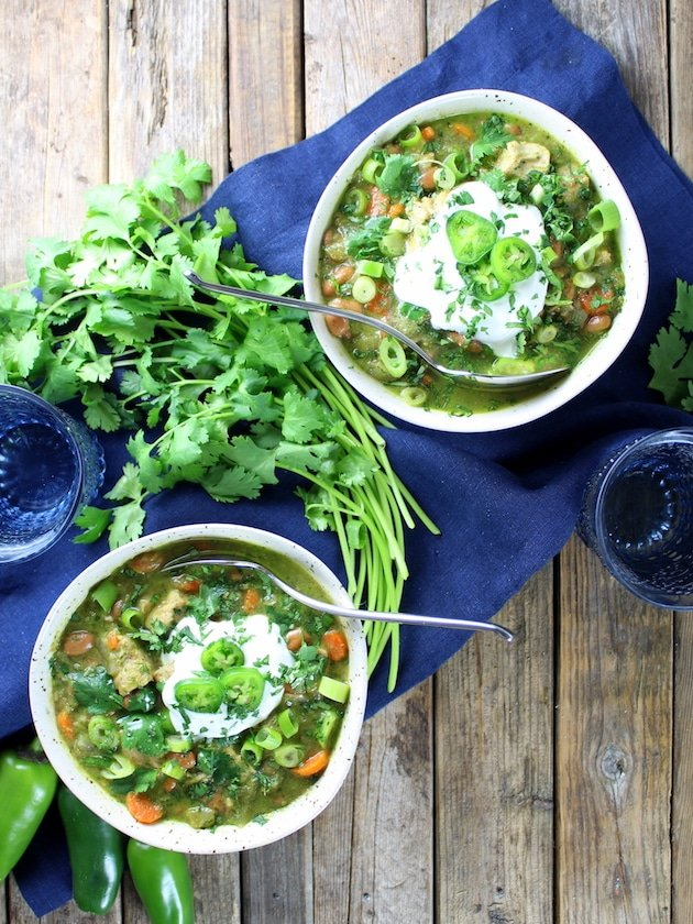 Two bowls of green chili verde chicken soup