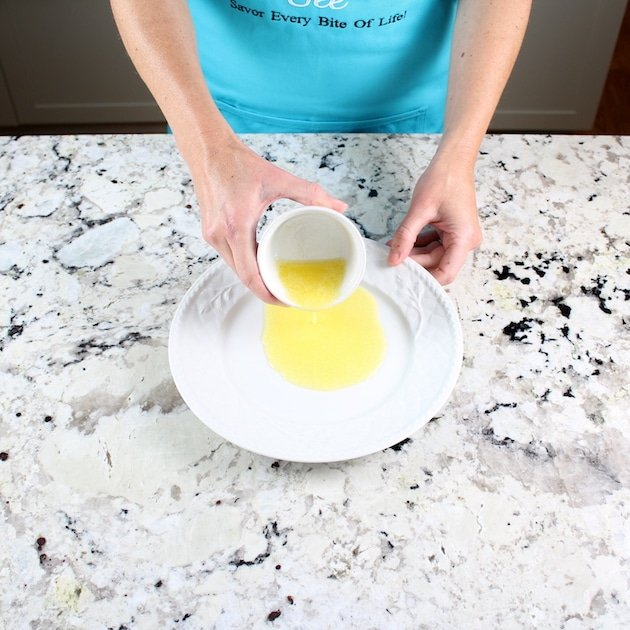 Adding lmelted butter to plate