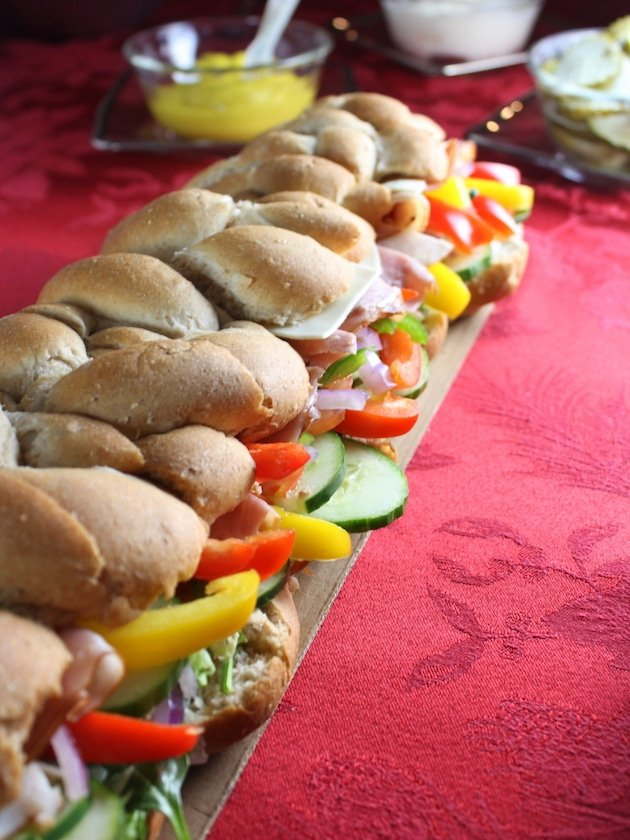 Eye level super long sub sandwich on holiday tablescape