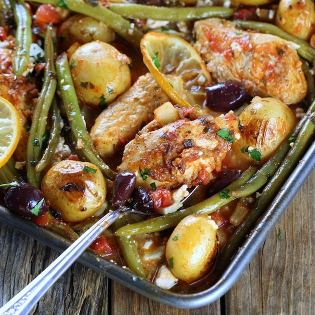 Close up partial Greek Chicken Sheet Pan Dinner with Green Beans and Feta