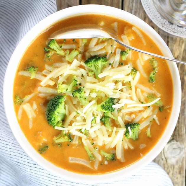 Smoky Cheesy Cauliflower and Broccoli Soup with shredded cheese
