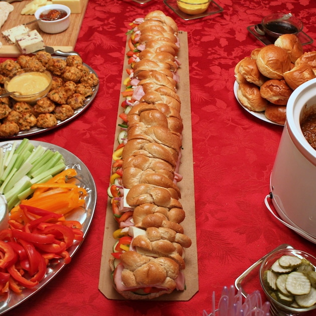 A super long sub sandwich on a holiday tablescape