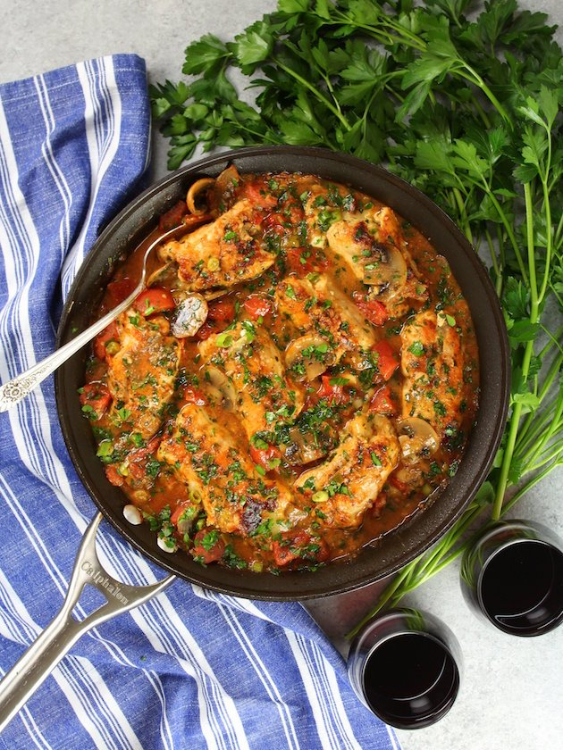 Cooked Chicken Canneloni in skillet with red wine and parsley