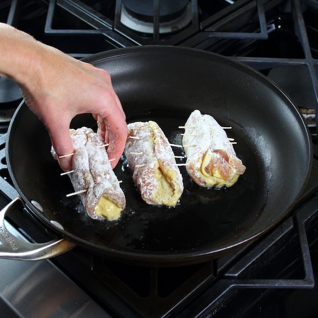 Adding dredged chicken to saute pan