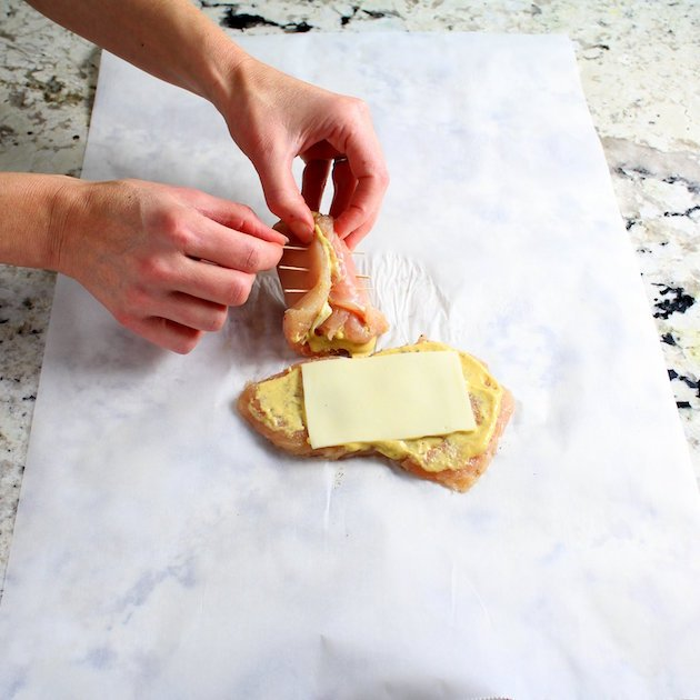 Securing rolled chicken breast with toothpicks