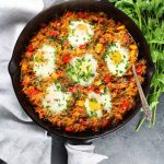 Breakfast skillet with chicken sausage and sunny side up eggs