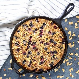 Berry crumble cake in cast iron skillet
