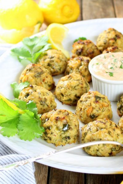 tuna cakes on a platter with yogurt dipping sauce