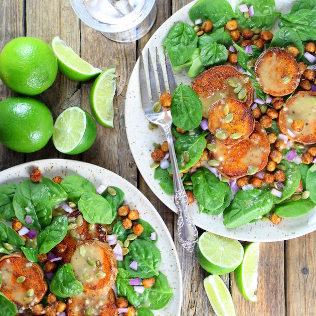 Sweet Potato and Chickpea Salad with Garlic Lime Maple Vinaigrette on white plates on farm table
