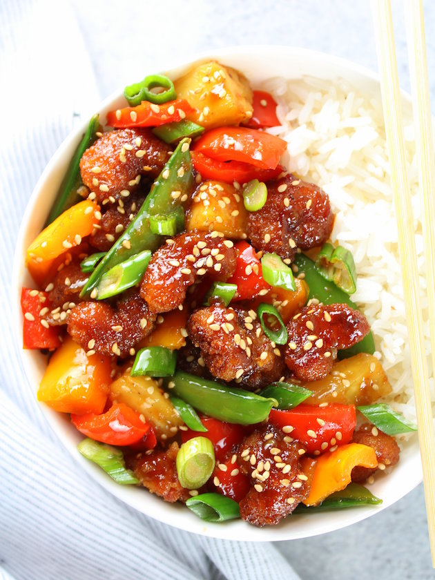 Sweet and Sour Shrimp Bowl Image: tangy sweet sauce with pineapple, peppers, onions and snap peas over light and fluffy rice.