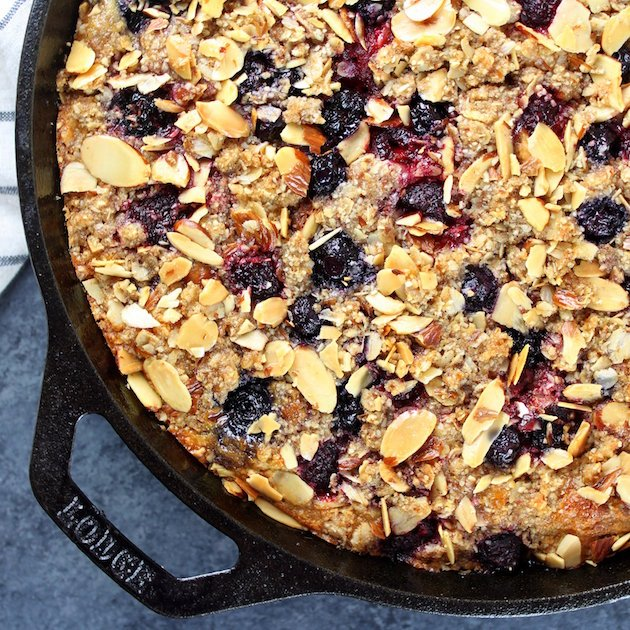 partial skillet cake with triple berry crumble