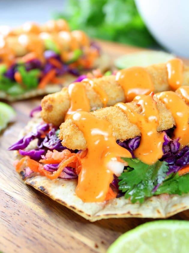 Bang Bang Fish Tacos Recipe Image - With lightly toasted corn tortillas, citrusy cabbage slaw, fish sticks, & Bang Bang!