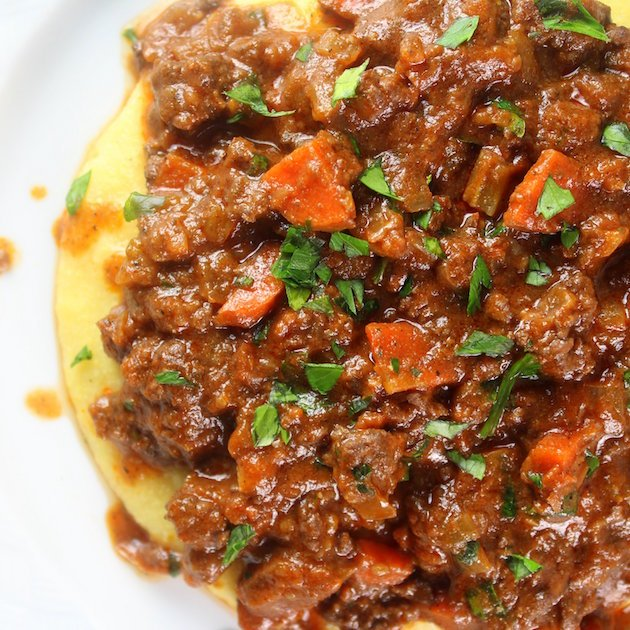 Easy Parmesan Polenta Bolognese Image - Classic Italian dinner with hearty meat sauce
