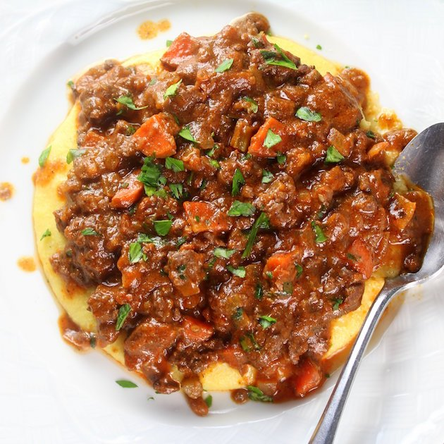 Easy Parmesan Polenta Bolognese Image - Classic Italian dinner with hearty meat sauce - Easy Weeknight Dinners