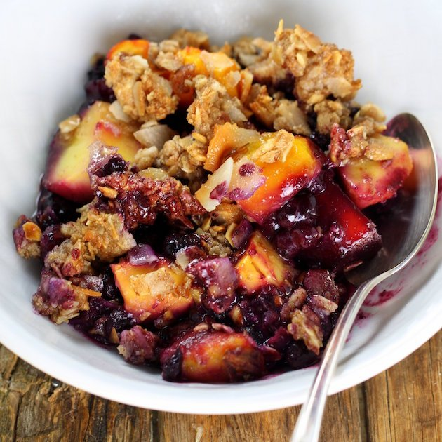 Tropical Blueberry Mango Coconut Crumble in a bowl - An easy fruit dessert