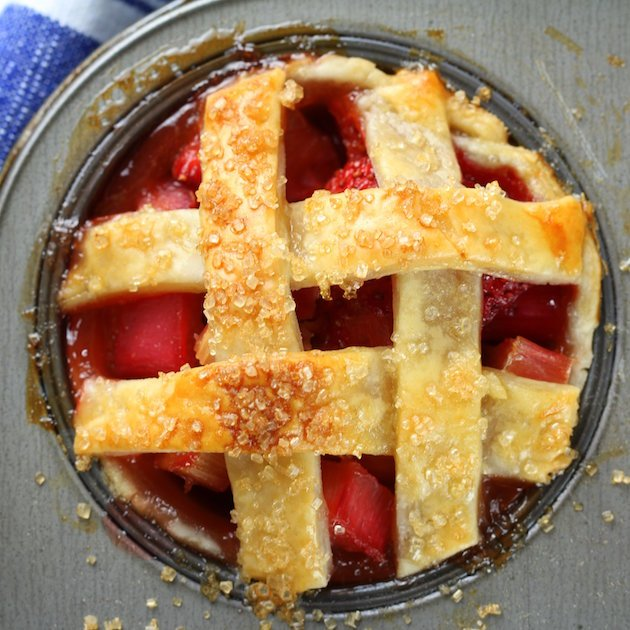 Close up Mini Strawberry Rhubarb Pie in Muffin Tin