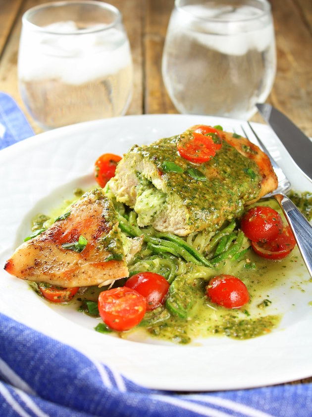 Stuffed chicken breast on bed of zucchini noodles