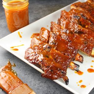 A plate of food with Ribs and Sauce