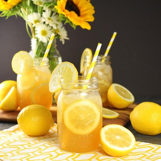 Mason jars with lemonade on table