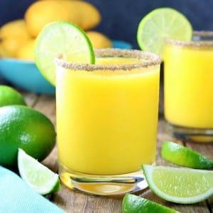 Salt-rimmed mango margarita with a lime wheel garnish