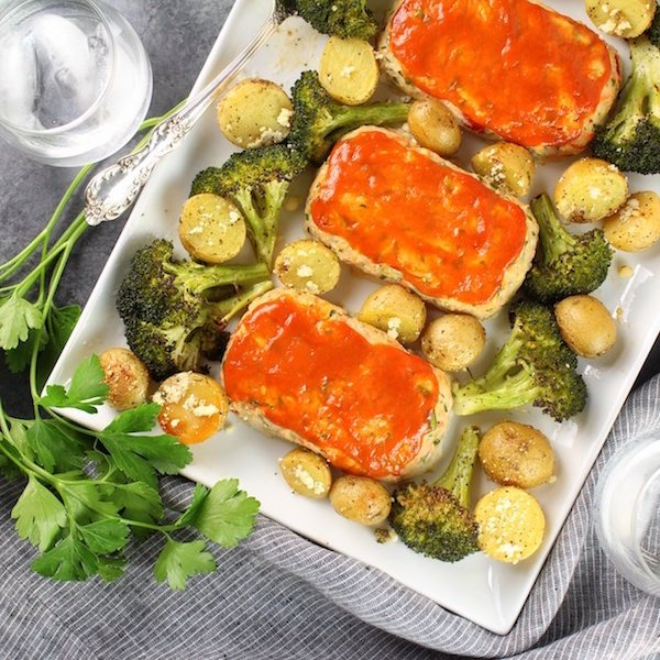 Turkey meatloaves on platter with broccoli and potatoes