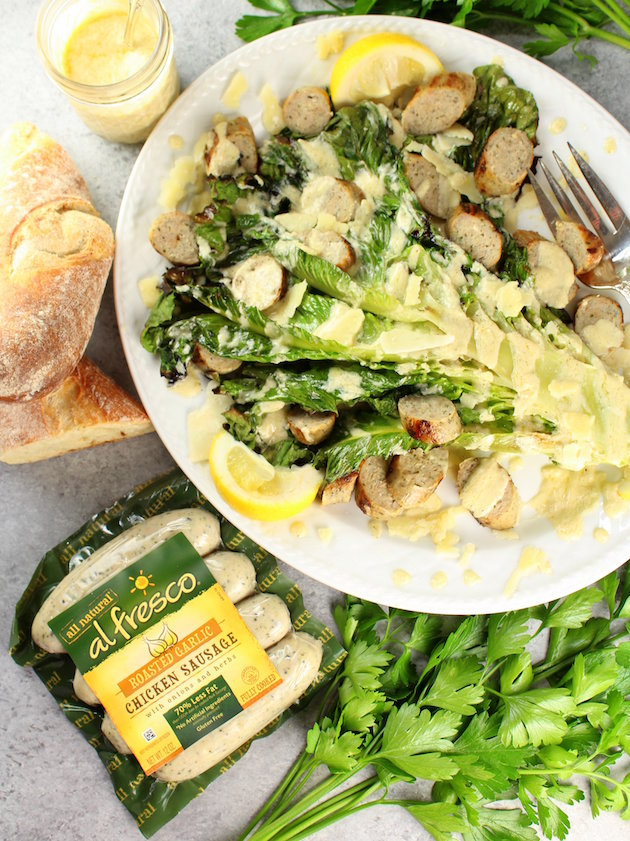 Grilled romaine lettuce head with caesar dressing