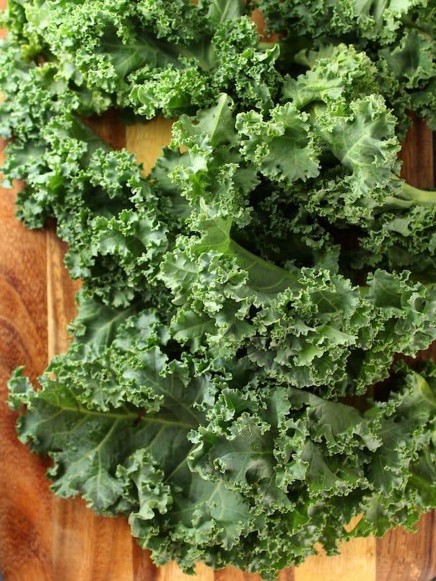 Fresh kale on cutting board