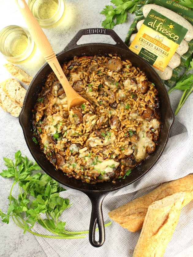Marsala Chicken Orzo Skillet with wooden spoon