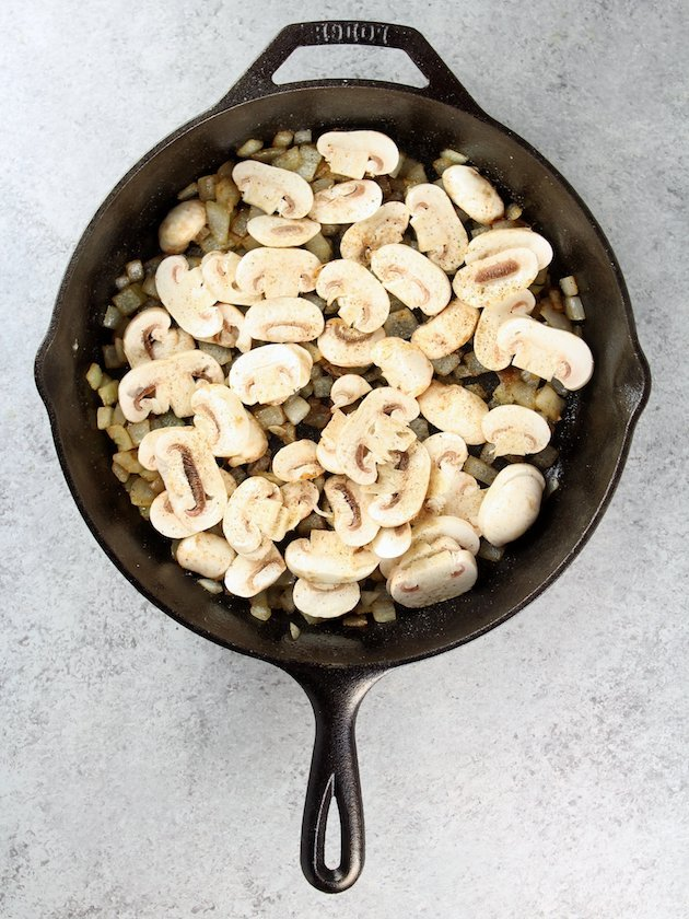Adding sliced white mushrooms to Marsala Chicken Orzo Skillet