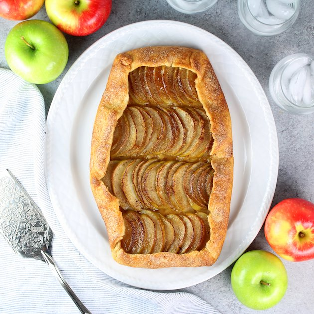 Apple Galette on table with apples