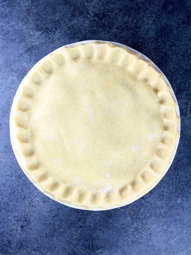 Pie with crimped edges before cooking